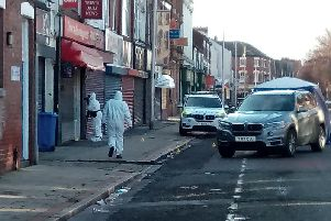 Forensics officers at the scene of the shooting on Hessle Road in Hull