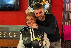 James Moorcroft with his gran after his last fight