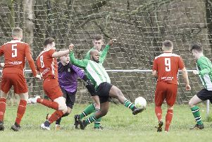 Tingley Athletic's Brandon Megson makes a clearance during last Saturday's Heavy Woollen District FA Wheatley Cup quarter-final against Hartshead. Poctures: Allan McKenzie