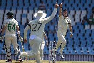 England's bowler James Anderson, right, celebrates with teammates after dismissing South Africa's Dean Elgar, far left, for a duck on day one of the first cricket test match between South Africa and England at Centurion Park, Pretoria. (AP Photo/Themba Hadebe)