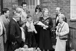 Margaret Thatcher hands over a copy of the deeds of 39 Amersham Road, Harold Hill, in Essex, to James Patterson, the GLC's 12,000 council house buyer.