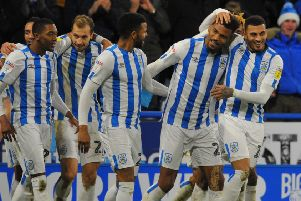 Steve Mounie is mobbed after his goal for Huddersfield helped beat Blackburn. But how many Town players made our Team of the Week? (Picture: Steve Riding)