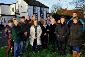 Residents of Holmpton village outside the George and Dragon pub on New year's Eve Picture: Gary Longbottom