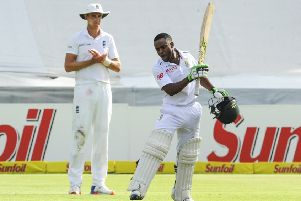 South Africa's Temba Bavuma, right, celebrates making a century against England in Cape Town back in 2016. Picture: AP
