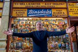 """""""We sell laughter - keep smiling"""" the sign says - manager Graham Williams certainly does!"""