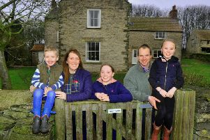 Chris Timm and his wife Lisa with children Oliver 5, Alice 10 and Isabelle 7 at their new home West Farm near Pickering