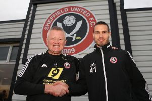 Manager Chris Wilder (left) welcomes new Sheffield United signing Jack Rodwell