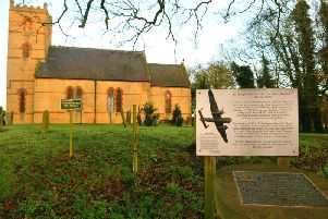 St Nicholas Church, Holmpton with the memorial to an RAF Bomber crew who crashed at nearby Mill Hill