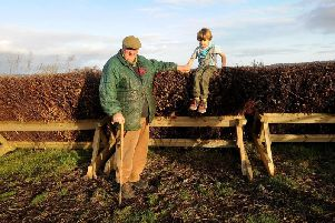 Mick Easterby pictured with his grandson Albert aged 5 by the fences ready for the new season.
