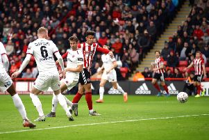Sheffield United's Callum Robinson, right, scores his side's first goal in their 2-1 FA Cup third round defeat of National League Fylde at Bramall Lane (Picture: Tim Goode/PA Wire).