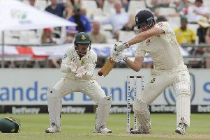 England's batsman Dom Sibley plays a shot as South Africa's wicketkeeper Quinton de Kock watches on.