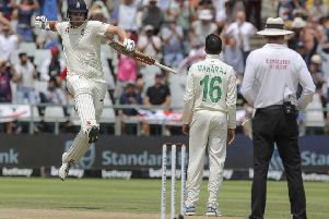 England's Dom Sibley celebrates scoring his maiden Test match century, coming against South Africa at Newlands, Cape Town. Picture: AP/Halden Krog