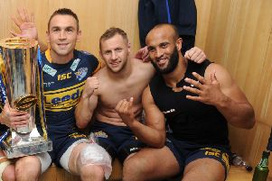 Reunited: Kevin Sinfield, Rob Burrow and Jamie Jones-Buchanan celebrtae a sixth Grand Final in 2012. (Picture: Steve Riding)