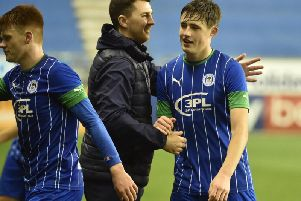 Under-18s chief Peter Murphy congratulates his side after Wednesday's historic win over Spurs