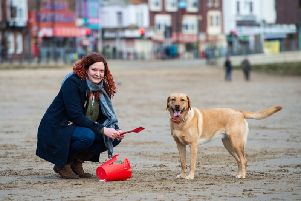 Molly and her owner Fliss Cater say they pick up hundreds of pieces of rubbish everyday. Credit: SWNS