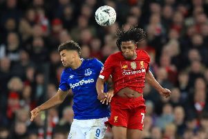 Everton's Dominic Calvert-Lewin (left) and Liverpool's Yasser Larouci battle for the ball during the FA Cup third round match at Anfield (Picture: PA)