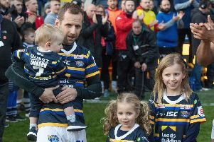 Rob Burrow with his children Macy, Maya and Jackson prior to kick off before the testimonial match at Emerald Headingley, Leeds. Photo: Dave Howarth/PA Wire.