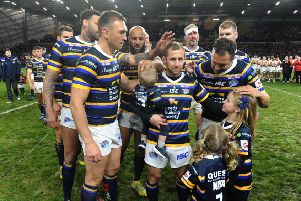 Rob Burrow with his children and former Leeds Rhins team-mates.
