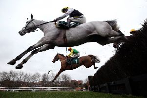 Joke Dancer and Danny Cook, rear, on their way to success at Warwick