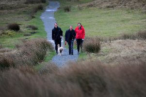 Mike Tomlinson with Jake Salter, Katy Dronsfield and dog Doris out walking the  area, a favourite with his late wife Jane. PIC: Simon Hulme