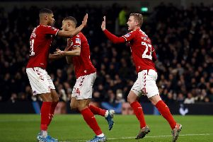 Middlesbrough's George Saville, right, celebrates scoring his side's goal against Spurs.