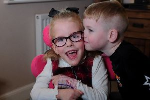 Little Esmae Robinson who suffers from Cerebral Palsy pictured with her  brother Riley who has autism at their home at Thorpe Willoughby, Selby Picture by Simon Hulme