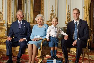 The Queen with Prince Charles, Prince William and Prince George in a rare photo to illustrate the line of succession.