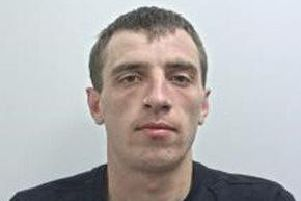 Aaron Scott (pictured) is described as 5ft10in to 6fttall, thin build, short brown hair and blue eyes. (Credit: Lancashire Police)