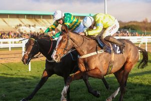 Cornerstone Lad (near side) won the Fighting Fifth Hurdle following a daring ride by Henry Brooke.