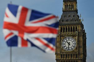 """A Union flag flies near the Elizabeth Tower, better known as """"Big Ben"""".  Picture: BEN STANSALL/AFP via Getty Images"""