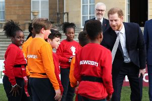 The Duke of Sussex meets children in the Buckingham Palace gardens, London, as he hosts the Rugby League World Cup draws.