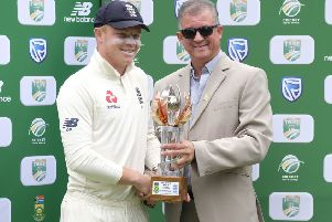 Top man: England's Ollie Pope, left, receives the man of the match trophy from Donovan May, president of Eastern Province cricket. Picture: AP Photo/Michael Sheehan
