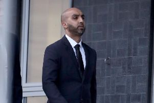West Yorkshire Police officer Amjad Hussain, 35, who also uses the surname Ditta, is pictured arriving at court.