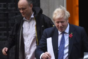 Boris Johnson leaves 10 Downing Street with his policy aide Dominic Cummings.