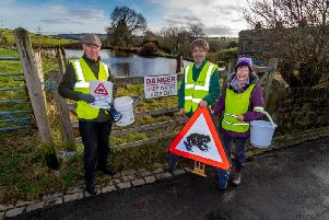 Steve Blacksmith, from Halifax Scientific Society, Hugh Firman, Conservation Officer for Calder Council, and Charlotte Weightman, from Halifax Scientific Society, near a toad breeding gound at Cottonstones close to Sowerby Bridge, where hundrends of toads will be returning to the Cottonstones Dam (Pond).