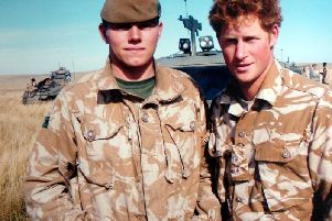 Cpl Liam Riley with Prince Harry on a training exercise in Canada.