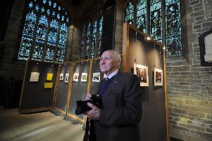 Photographer Brian Goodall, who is blind, is pictured with his exhibition of photographs at Wakefield Cathedral.