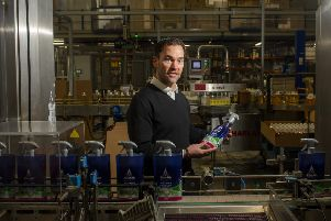 Howard Moss, managing director of cleaning products manufacturer Astonish on the production line at the Bradford-based factory. Picture: Tony Johnson