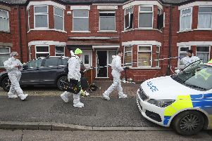 Forensics officers at the scene of a fire at a house on Wensley Avenue, Hull, where two people have died, including an eight-year-old. Danny Lawson/PA Wire