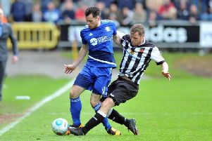 Jordan Sinnott, pictured in blue, in action for FC Halifax Town. PIC: Tony Johnson