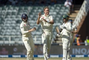 England's bowler Stuart Broad, centre, celebrates with team-mate Ollie Pope, left, after dismissing South Africa's batsman Dwaine Pretorius.