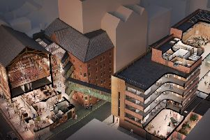 An architect's visualisation of the redeveloped Opera North estate, showing the Howard Assembly Room, new restaurant, box office and atrium on the left and the Howard Opera Centre on the right. Credit: Opera North.
