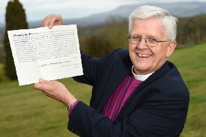 Rt Rev. Julian Henderson, the Bishop of Blackburn, with his writ of summons