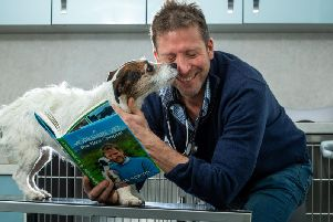 Yorkshire vet Julian Norton with his new book and Emmy the Jack Russell.