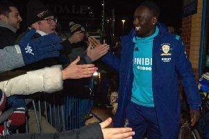 What will Jean-Kevin Augustin, who is pictured greeting Leeds United fans upon his arrival at Elland Road on Tuesday night, be? (Picture Bruce Rollinson)