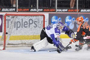 Lucas Sandtrom, right, squeezes the puck past Glasgow goalie Patrick Killeen in Wednesday's 4-0 win for Sheffield Steelers. Picture: Dean Woolley.