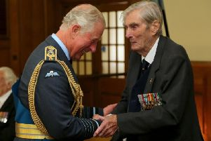 The Prince of Wales talking to Battle of Britain veteran Wing Commander Paul Farnes, who has died aged 101. Credit: Gareth Fuller/PA Wire