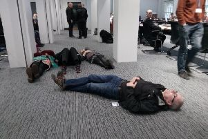 Protesters stage a 'die-in' at Leeds Civic Hall.