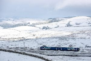 A Northern service on the Settle to Carlisle line during heavy snowfall