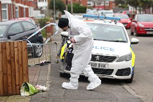 Forensics officers at the scene of the fire on Wensley Avenue on January 25 Picture: Danny Lawson/PA Wire